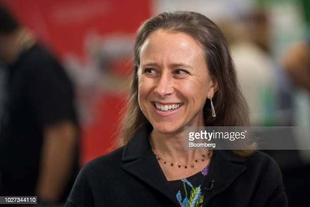 Anne Wojcicki chief executive officer and cofounder of 23andMe Inc smiles during a Bloomberg Technology Television interview at the TechCrunch...