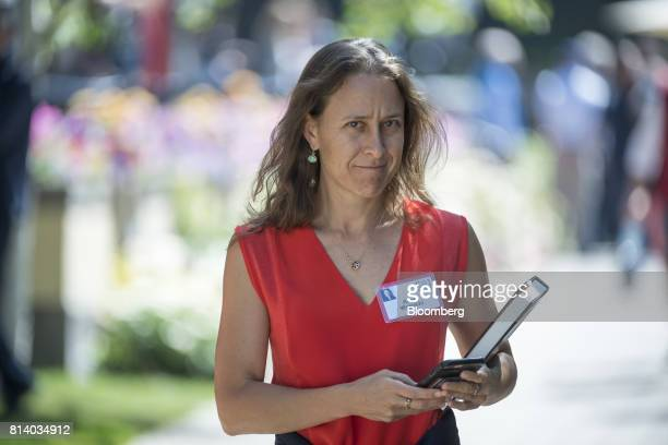 Anne Wojcicki chief executive officer and cofounder of 23andMe Inc walks the grounds after the morning session during the Allen Co conference in Sun...