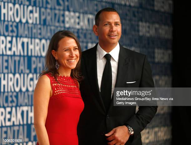 Anne Wojcicki cofounder and CEO of 23andMe poses for a picture with her boyfriend former Major League Baseball player Alex Rodriquez on the red...