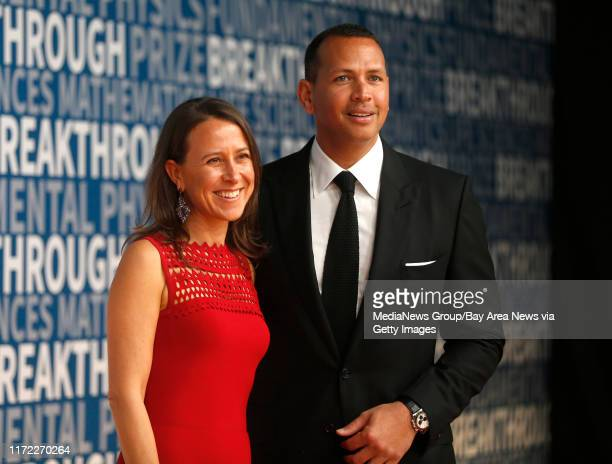 Anne Wojcicki, co-founder and CEO of 23andMe, poses for a picture with her boyfriend former Major League Baseball player Alex Rodriquez on the red...