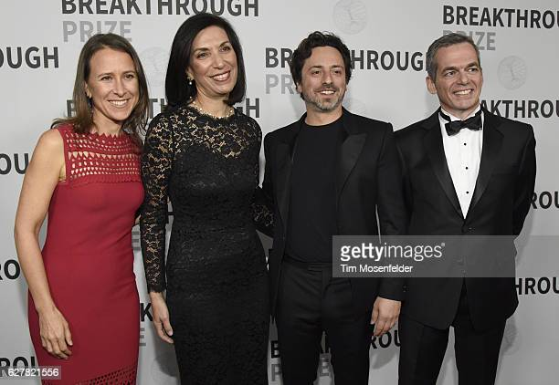 Anne Wojicki Huda Zoghbi Sergey Brin and Joseph Polchinski attends the 5th Annual Breakthrough Prize Ceremony at NASA Ames Research Center on...