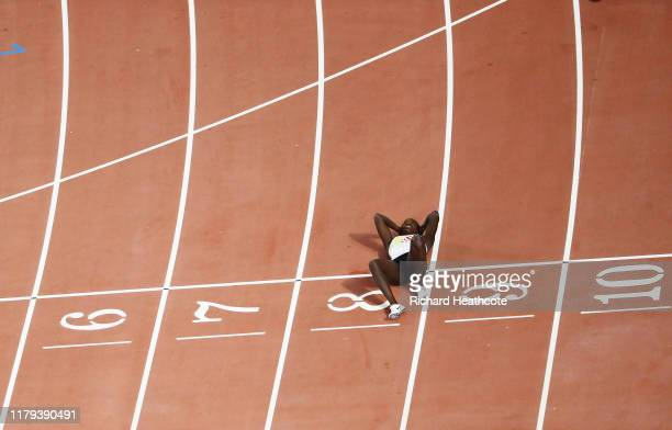 Anne Zagre of Belgium lies on the finish line in the Women's 100 metres hurdles semi finals during day ten of 17th IAAF World Athletics Championships...