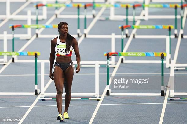 Anne Zagre of Belgium reacts after being disqualified during the Women's 100m Hurdles Semifinals on Day 12 of the Rio 2016 Olympic Games at the...