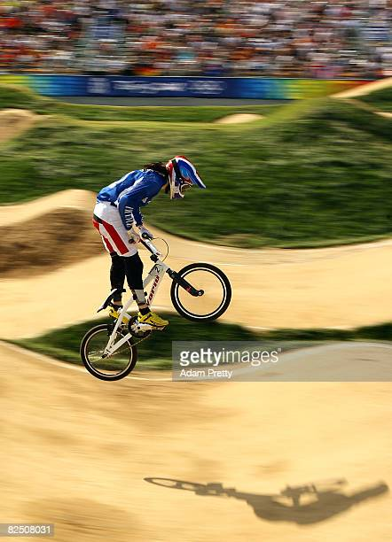 Anne-Caroline Chausson of France competes in the Women's BMX semifinals held at the Laoshan Bicycle Moto Cross Venue during Day 14 of the Beijing...