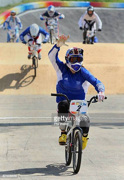 Anne-Caroline Chausson of France crosses the line to win the gold medal in the women's BMX final held at the Laoshan Bicycle Moto Cross Venue during...