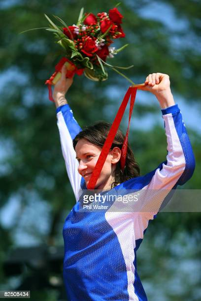 Anne-Caroline Chausson of France holds the gold medal during the medal ceremony for the women's BMX semifinals held at the Laoshan Bicycle Moto Cross...