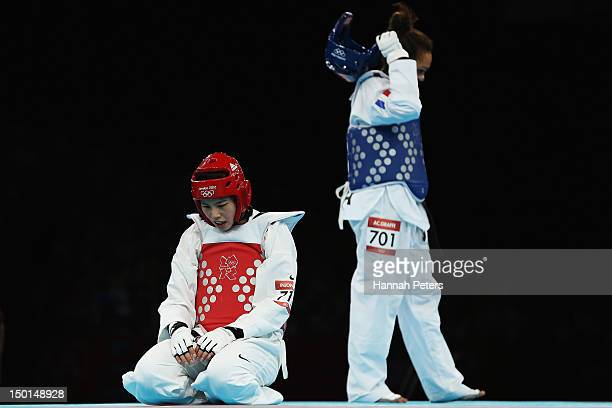 AnneCaroline Graffe of France celebrates beating In Jong Lee of Korea during the Women's 67kg Taekwondo quarterfinal match on on Day 15 of the London...