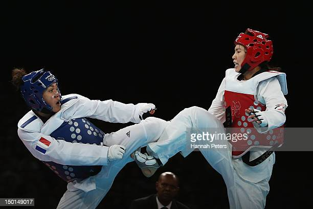 AnneCaroline Graffe of France competes against Jong Lee of Korea during the Women's 67kg Taekwondo quarterfinal match on on Day 15 of the London 2012...