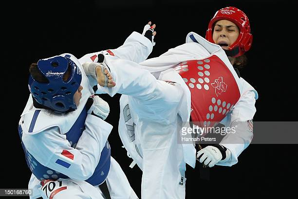 AnneCaroline Graffe of France competes against Milica Mandic of Serbia during the Women's 67kg Taekwondo Gold medal match on on Day 15 of the London...