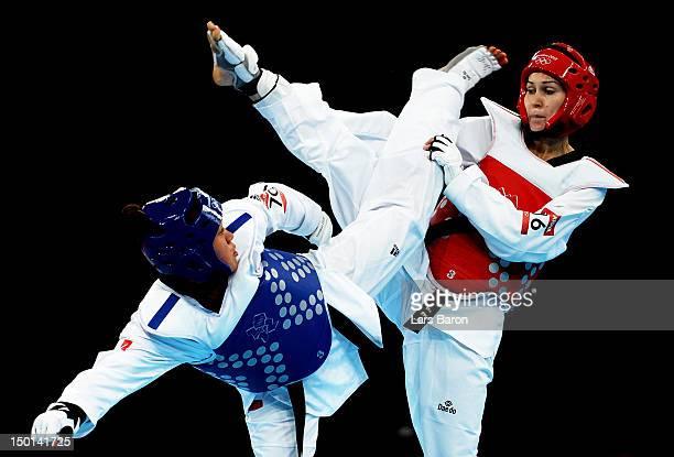 Anne-Caroline Graffe of France competes against Natalya Mamatova of Uzbekistan during the Women's +67kg Taekwondo Preliminary Roundon on Day 15 of...