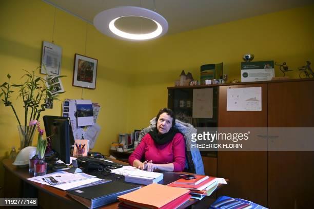 Anne-Catherine Weber, mayor of Plobsheim, a town near Strasbourg of 4,400 inhabitants, poses in her office in Plobsheim, eastern France, on January...