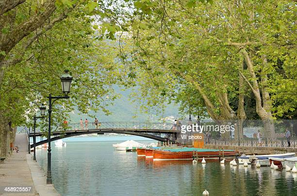 annecy lake and canal scenery - lake annecy stock photos and pictures