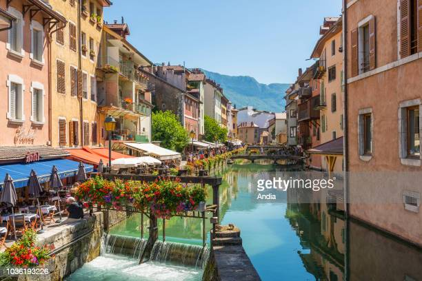 properties with colorful frontage on the banks of the Thiou river in the old town on the riverbanks of Lake Annecy Locks on the Thiou