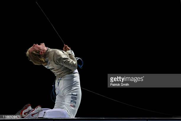 AnneElizabeth Stone of the United States celebrates after defeating Maria Belen Perez Maurice of Argentina in the fencing Women's Sabre Individual...