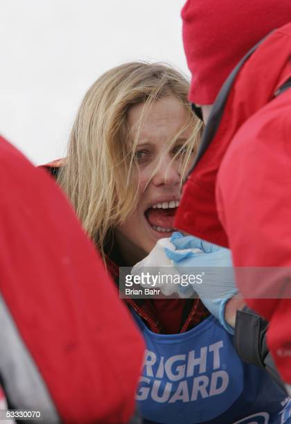 AnneFlore Marxer of Switzerland loses a bit of blood after a hard landing during warmups at the finish of the women's Snowboard Slopestyle...