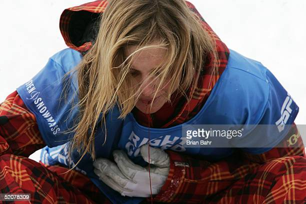 AnneFlore Marxer of Switzerland spits out a bit of blood after a hard landing during warmups at the finish of the Women's Snowboard Slopestyle...