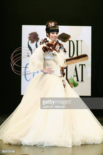 AnneGaelle Riccio displays a chocolate decorated dress during the Chocolate dress fashion show celebrating the opening of the 14th Salon du Chocolat...