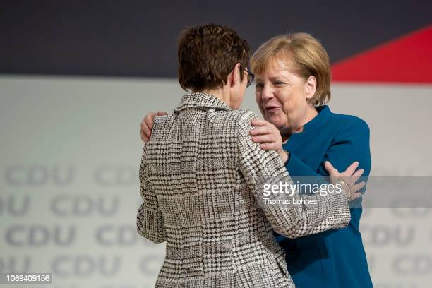 Annegret KrampKarrenbauer and Angela Merkel react after after KampKarrenbauer received the most votes to become the next leader of the German...