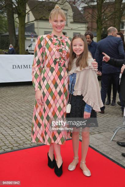Annegret KrampKarrenbauer and Emily arrive at the 54th Grimme Award on April 13 2018 in Marl Germany