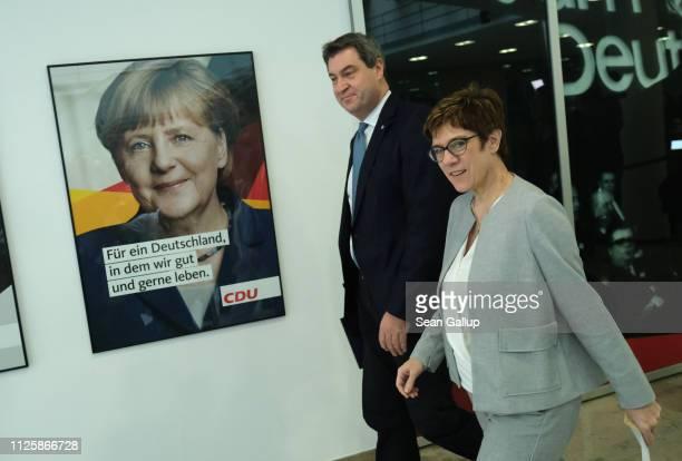Annegret KrampKarrenbauer chairwoman of the German Christian Democrats and Markus Soeder chairman of the Bavarian Christian Democrats walk past a...