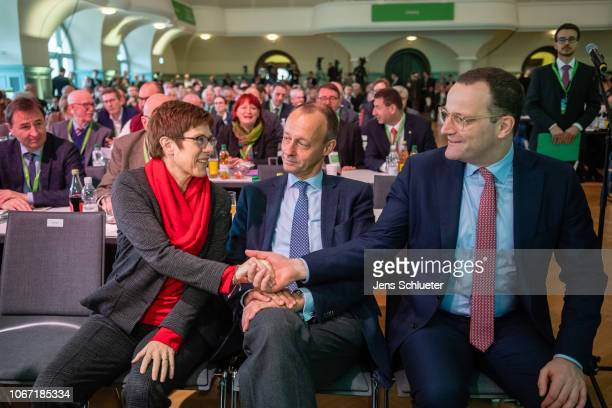 Annegret KrampKarrenbauer Friedrich Merz and Jens Spahn of the German Christian Democrats attend at a CDU Saxony state congress on December 1 2018 in...