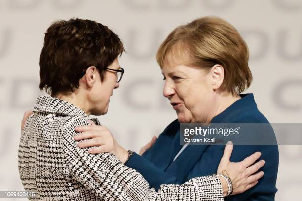 Annegret KrampKarrenbauer is congratulated by Angela Merkel after receiving the most votes to become the next leader of the German Christian...