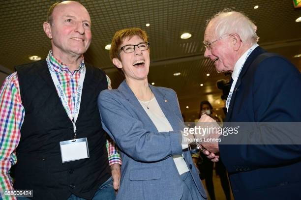 Annegret KrampKarrenbauer lead candidate of the German Christian Democrats reacts after initial elections results gave the SPD a second place finish...