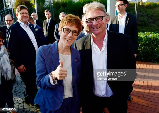 Annegret KrampKarrenbauer lead candidate of the German Christian Democrats speaks to the press after initial elections results gave the SPD a second...