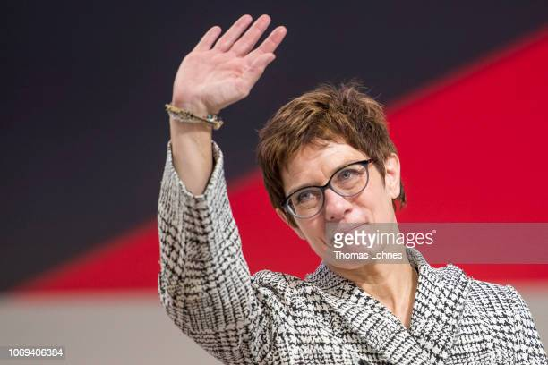 Annegret Kramp-Karrenbauer waves to delegates after receiving the most votes to become the next leader of the German Christian Democrats at a federal...