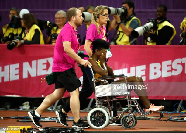 Anneisha MclaughlinWhilby of Jamaica is helped of the track in a wheelchair after the Women's 4x400 Metres Relay final during day ten of the 16th...