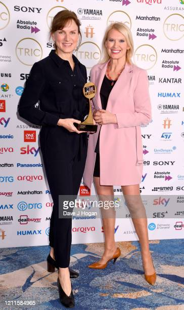 Anneka Rice with Fiona Bruce wins the News Presenter Award during the TRIC Awards 2020 at The Grosvenor House Hotel on March 10 2020 in London England