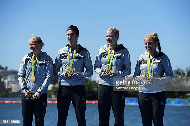 Annekatrin Thiele Carina Baer Julia Lier and Lisa Schmidla of Germany with their gold medals after winning Women's Scull Final A on Day 6 of the 2016...