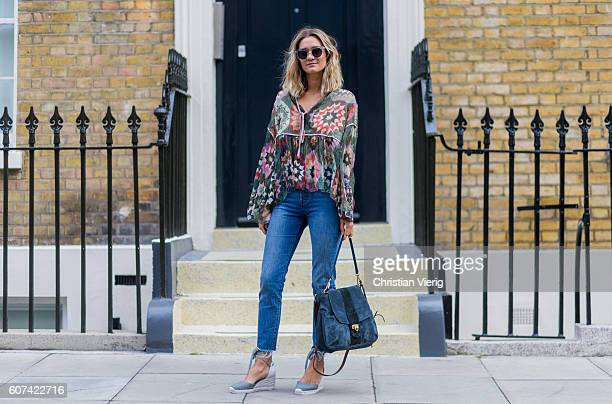 AnneLaure Mais wearing a blouse Chloe Lexa bag and denim jeans during London Fashion Week Spring/Summer collections 2017 on September 17 2016 in...