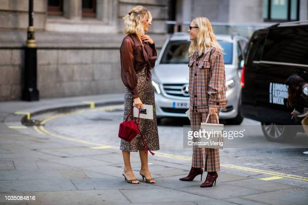 AnneLaure Mais wearing animal print skirt brown blouse sandals bordeaux bag and Jessie Bush wearing brown checked suit is seen outside Erdem during...