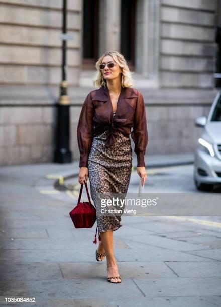 AnneLaure Mais wearing animal print skirt brown blouse sandals bordeaux bag is seen outside Erdem during London Fashion Week September 2018 on...