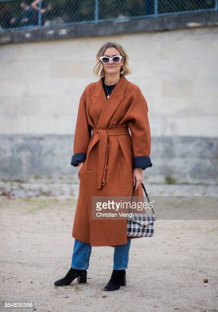 Anne-Laure Mais wearing brown coat is seen outside Lacoste during Paris Fashion Week Spring/Summer 2018 on September 27, 2017 in Paris, France.