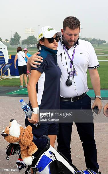 AnneLise Caudal of France is consoled by the Tournament Director Michael Wood after her caddie collapsed on the course which led to an immediate...