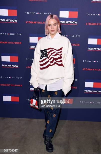 AnneMarie attends the TommyNow show during London Fashion Week February 2020 at the Tate Modern on February 16 2020 in London England
