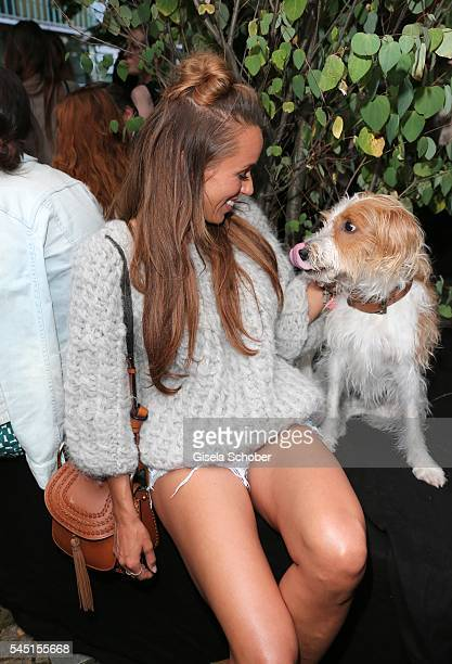 Annemarie Carpendale and her dog Seppi during the Iris von Arnim by Unuetzer launch party of the cashmere sneaker at Bob Beaman Club on July 5 2016...