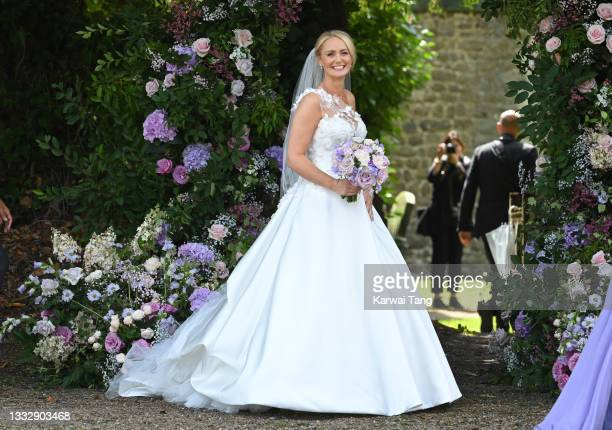 Anne-Marie Corbett arrives for her wedding to Ant McPartlin at St Michael's Church in Heckfield on August 07, 2021 in Hook, Hampshire.