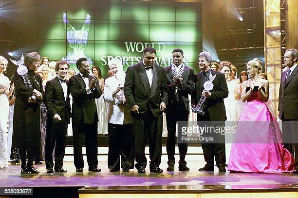 Annemarie MoserProell Alain Prost Pele Dawn Fraser Carl Lewis Mark Spitz Nadia Comaneci and JeanClaude Killy applause Muhammad Ali as he receives the...
