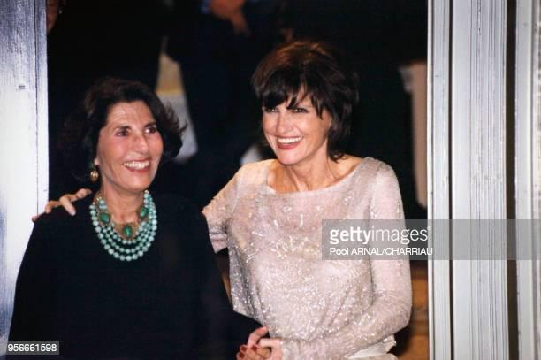 AnneMarie Perier et sa mère à la soirée de mariage de Michel sardou chez Azzedine Alaia le 11 octobre 1999 à Paris France