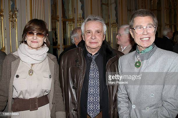AnneMarie Perier singer Michel Sardou and JeanPaul Goude attend the 'Personalities Of Design And Photography Honored' ceremony at Ministere de la...
