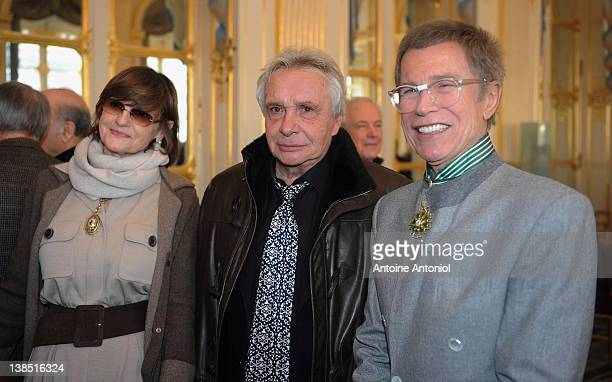 Anne-Marie Périer , singer Michel Sardou and designer, illustrator, photographer and advertising director Jean-Paul Goude attends a ceremony...