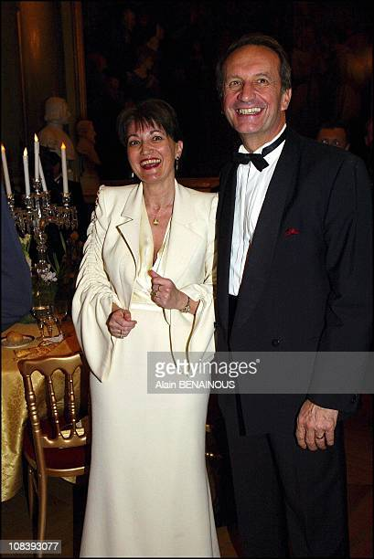 Anne-Marie Raffarin and Gerard Longuet In Versailles, France on January 01, 2004.