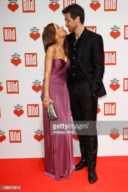 Annemarie Warnkross and Wayne Carpendale arrive for the 'Ein Herz fuer Kinder' Charity gala on December 17 2011 in Berlin Germany