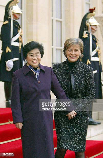 AnneMarie wife of French National Assembly President JeanLouis Debre welcomes Liu Yongqing wife of Chinese President Hu Jintao 27 January 2004 at the...