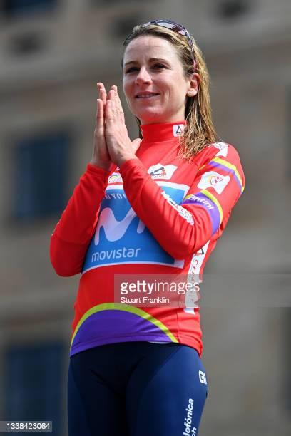 Annemiek Van Vleuten of Netherlands and Movistar Team celebrates winning the red leader jersey on the podium ceremony after the 7th Ceratizit...