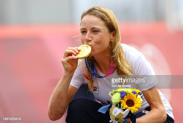 Annemiek van Vleuten of Team Netherlands kisses her gold medal after the Women's Individual time trial on day five of the Tokyo 2020 Olympic Games at...