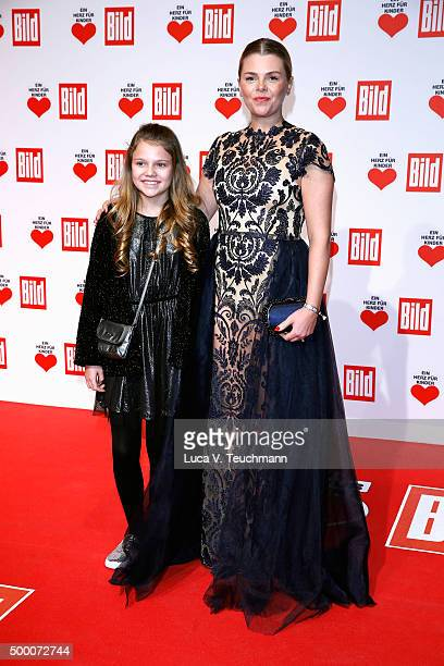 AnneSophie Briest and daughter Faye Montana arrive for the Ein Herz Fuer Kinder Gala 2015 at Tempelhof Airport on December 5 2015 in Berlin Germany